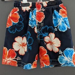 Orange and blue hawaiian flower print swim trunks